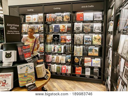 New York June 1 2017: A woman is browsing a newly opened Amazon Books store in Time Warner Center.