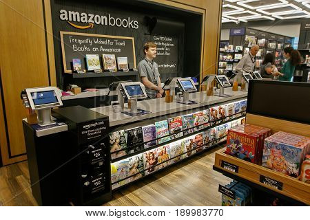 New York June 1 2017: A clerk stands behind the checkout counter in a newly opened Amazon Books store in Time Warner Center.