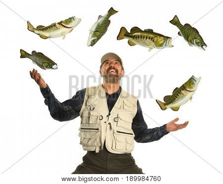 Hispanic fisherman juggling large and small mouth bass fish isolated over white background