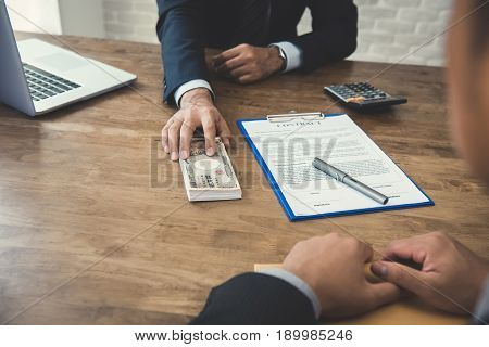 Businessman giving money Japanese yen banknotes while making contract - loan debt bribery and corruption concepts