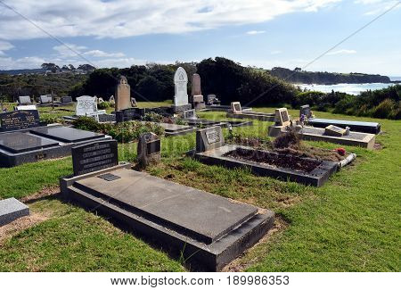 Narooma Australia - Apr 15 2017. Narooma graveyard is an amazing artistic cemetery with very individual graves with to the sea and Glasshouse Rocks beach.