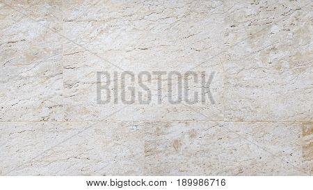 Wall pattern of travertine stone tile background.