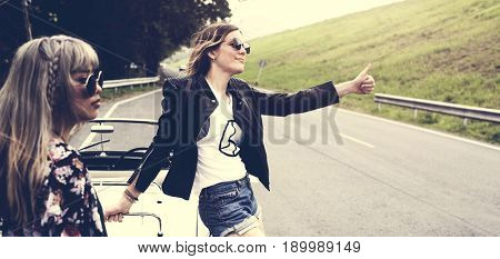 Woman Hitch Hiking on The Street Side Near The Broke Down Car