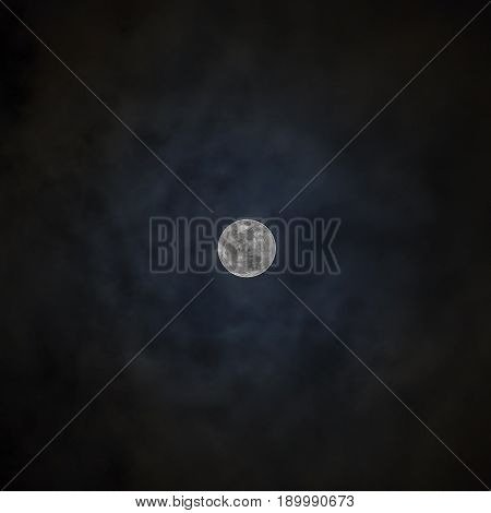 Full moon over dark black sky and cloud night