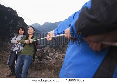 Chinese friends playing tug of war