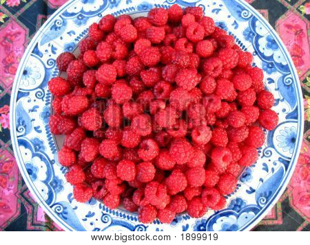 Raspberries On Plate