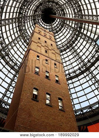 MELBOURNE, AUSTRALIA - MAY 13  2017: Melbourne's Shot Tower which was built on the site in 1888 is an iconic building contained underneath a massive glass dome at the Melbourne Central shopping centre