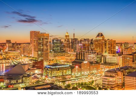 Baltimore, Maryland, USA inner harbor and downtown skyline at dusk.