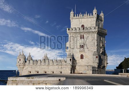 Belem Tower on the background of blue sky on a sunny summer day. Lisbon Portugal
