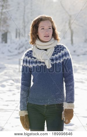 Caucasian woman standing in snow