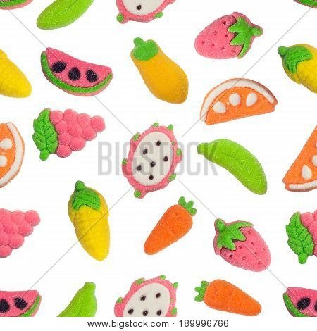 Seamless pattern of fruit and vegetable shaped gummy candy isolated on white background