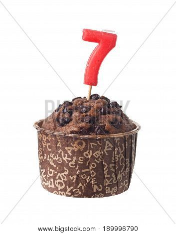 Chocolate muffin with birthday candle for seven year old isolated on white background
