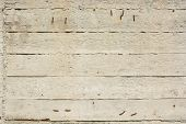 Close up obsolete concrete wall with traces of wooden planks on it poster