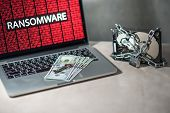 Hard disk file locked with monitor show ransomware cyber attack internet security breaches. Malware lock file concept for security article i.e. WannaCry or WannaCrypt attack all over the world poster