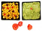 Bowl of Southwestern Corn, Guacamole and Peppadew Peppers over white. poster
