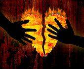 Broken heart & hands on grunge wooden background poster