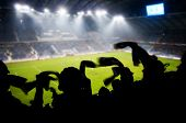 Silhouettes of fans celebrating a goal on football / soccer match poster