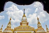 Phra Maha Chedi Chai Mongkol a highly-revered pagoda containing relics of Buddha located at Wat Pha Namthip Thep Prasit Vararam a temple complex in Roi Et province northeastern Thailand poster