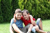Portrait of two boys, siblings, brothers and best friends smiling. Friends hugging. poster
