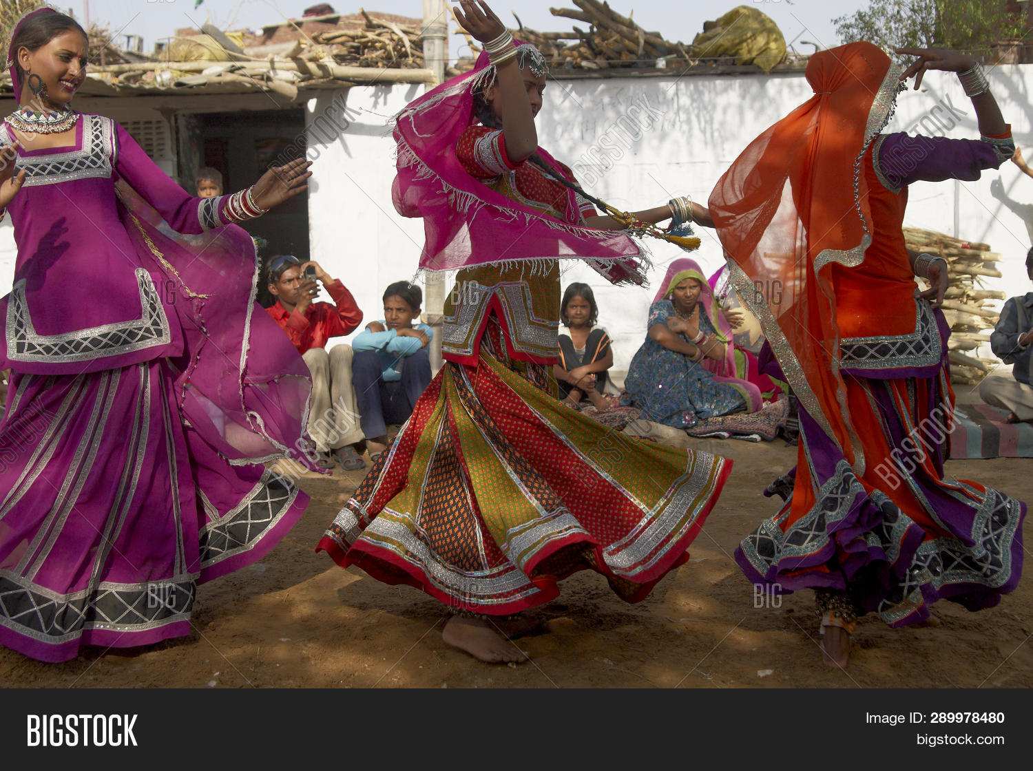 a562cf684aee Jaipur, Rajasthan, India - March 9, 2009: Tribal dancers in colourful  costumes performing a traditional dance outside in their home community in  Jaipur, ...