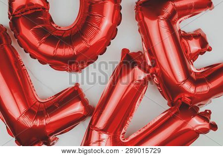 Red love blown up balloons poster
