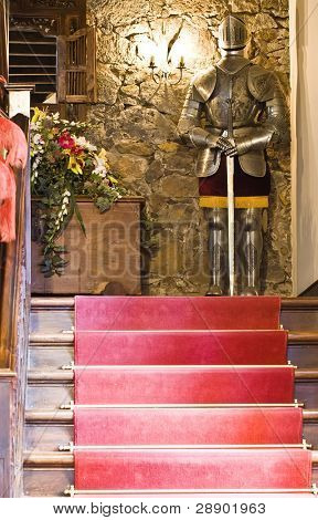 Suite of armor at the end of the stairs
