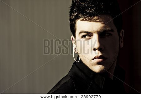 Young model performing security agent in the darkness