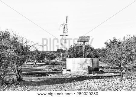 A Water-pumping Windmill And Solar Panels For A Waterpump Near Schmidtsfrift, A Village In The North