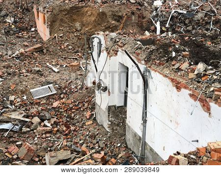 Wall Remnants And Rubble After House Demolition Or Teardown