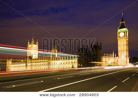 Nocturne scene with Big Ben behind light beams