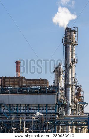 Oil petrochemical Factory plant with gas storage and structure of pipeline with smoke from smokestack in Kawasaki City near Tokyo Japan poster