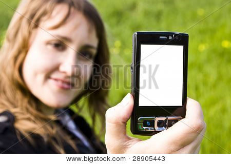 Blond smiling woman showing a black mobile phone.