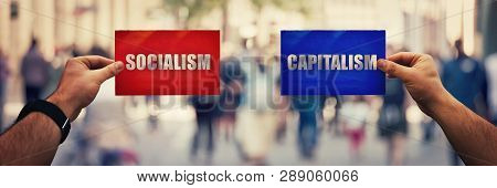 Two Hands Holding Different Colored Paper Sheet As Socialist Centralized Economic Planning Versus Ca