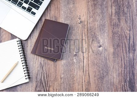 Passport On Wooden Desk Table.travel Planning.top View Of Traveler Accessories With Two Passports, N