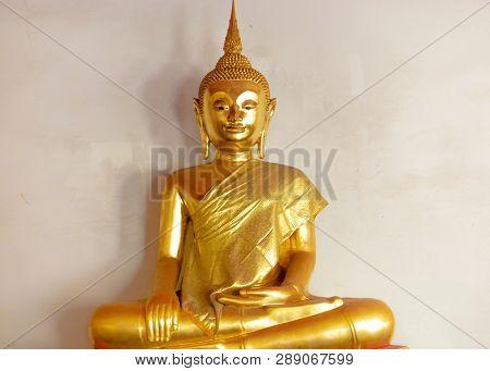Golden Buddha Satue In A Buddhist Temple Thailand