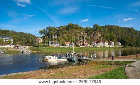 Rathen, Germany - October 04, 2018: Ferry Traffic In The Resort Rathen In The Elbe Sandstone Mountai