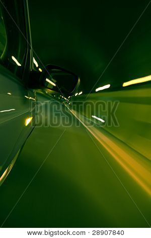 Driving fast inside tunnel, green toned.