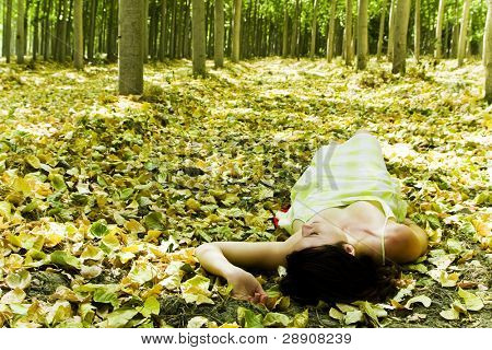 Young woman laying in the woods