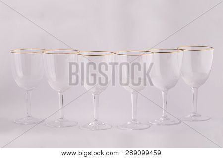 Stemware Glasses For Drinks Made Of Czech Glass With Golden Lines Isolated On A White Background.