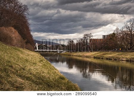 Image - City In Slovakia (nitra) With Nitra River With Bridge On Background - Stormy Weather. Photo