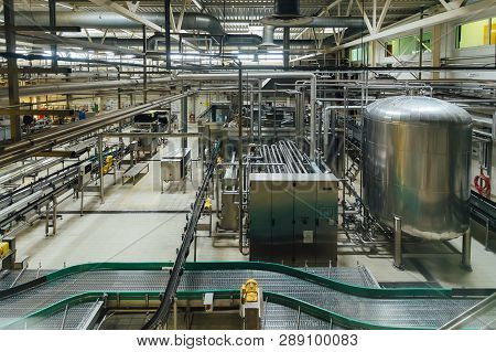 Modern Brewery Production Line. Large Vat For Beer  Fermentation And Maturation, Pipelines And Filtr