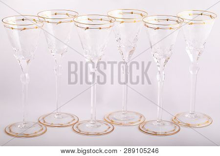 Stemware Faceted Glasses Made Of Czech Glass With A Golden Lines And Ornament Isolated On A White Ba