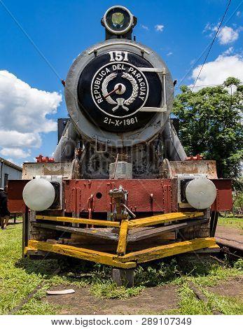 Villarrica / Paraguari, Paraguay - November 21, 2018: Old Rusted Steam Locomotive In Paraguay. In Pa
