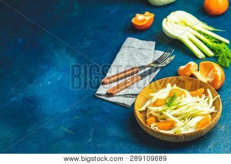 Fennel And Orange Citrus Salad On Wooden Plate Between Ingredients