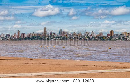 Skyline Of Posadas In Argentina, Photographed From The Beach In Encarnacion / Paraguay.