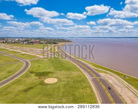Aerial View Of Encarnacion In Paraguay Overlooking The Bridge To Posadas In Argentina.