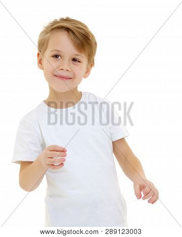 A Cute, Emotional Little Boy In A Clean White T-shirt. On Which You Can Write A Company Logo Or Adve