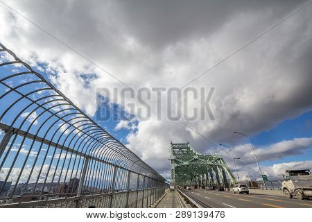 Montreal, Canada - November 8, 2018: Cars & Truck Traffic On The Highway Of Jacques Cartier Bridge,