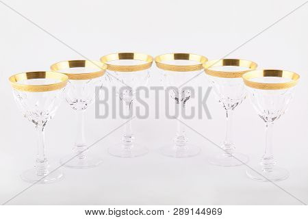 Stemware Faceted Glasses Made Of Czech Glass With A Golden Ornament Isolated On A White Background.