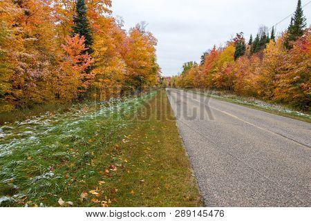 Diminishing Two Lane Road. Rural Asphalt Highway Through An Autumn Forest In The Hiawatha National F